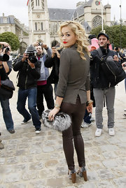Brtiannique showed off her fur embellished clutch while hitting Paris Fashion Week.