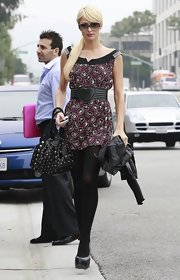 Paris showed off her summer style in a printed dress, black tights and a black studded shoulder bags.