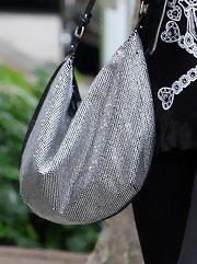 While making her weekly trip to the salon Paris showed off this shimmering studded hobo bag.