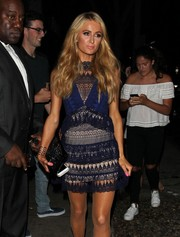 Paris Hilton paired a beaded clutch with a lace mini dress for a party in West Hollywood.