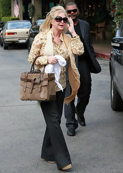 Kathy Hilton strolled through Bel Air with a luxe taupe suede tote.