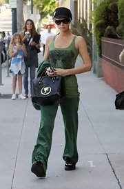 The heiress stepped out with a right one trend all green ensemble and a black patent leather handbag. The shiny toted featured the barbie logo in gold. Cute!
