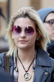 Paris Jackson shielded her eyes with a pair of purple round shades.
