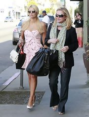 Kathy Hilton livened up her blazer and jeans combo with a fringed patterned scarf.
