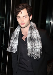 Penn Badgley was out and about in New York wearing a black-and-white plaid scarf.