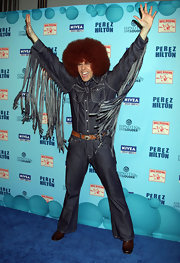 Perez Hilton brought the '70s to life with his tasseled blue denim shirt, bell-bottom pants, and afro wig during his birthday celebration.