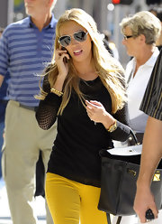 Petra Ecclestone went shopping in a fitted knit sweater with sheer pointelle sleeves.