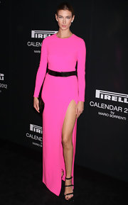 Lauren Remington Platt was right on trend at the Pirelli Gala in a hot pink maxi-dress with a hip-high slit and black patent accessories.