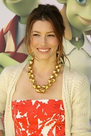 Jessica looked almost resort-ready in her red-and-white print strapless dress topped with a tribal gold bead necklace.
