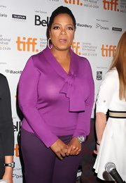 Oprah Winfrey wore a very feminine purple tie-neck sweater to the 'Precious' press conference.