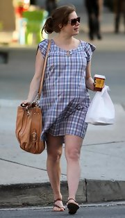 A very pregnant Amy Adams is seen out ad about making a coffee run. She kept her outfit  casual and simple but added a cute tan tote bag to punch it up a little.