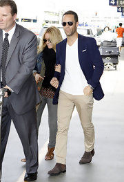 Chris looks suave in a navy suit jacket and khaki slacks.