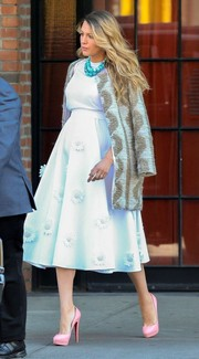 Blake Lively dressed up her baby bump in an all-white ensemble and patterned coat with pink pumps.