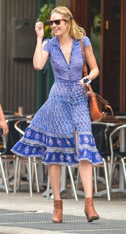 Candice Swanepoel was spotted out in New York City looking cute in a blue mixed-print shirtdress.