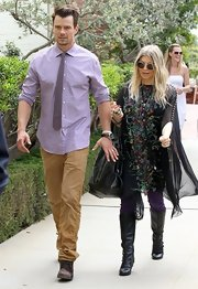 Josh Duhamel chose a pastel purple button down for his springtime-inspired look while attending Easter Sunday Church.