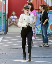 Gwen Stefani looked totally funky in a distressed white knit top while dropping off Zuma at school.