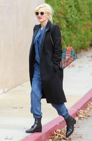 Gwen Stefani added a splash of color to her outfit with a plaid shoulder bag while out and about in LA.