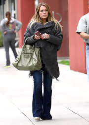 Hilary Duff's woolen gray duster swallowed up her petite frame.