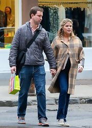 Jenna Bush shopped at Giggles baby store in white canvas sneakers.