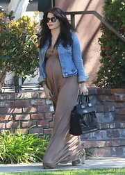 Jenna Dewan-Tatum paired a casual denim jacket with a brown maternity dress for her daytime look while out in California.