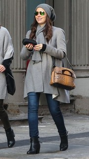 Jessica Biel went shopping in NYC looking cozy in black ankle boots, jeans, and a gray coat.
