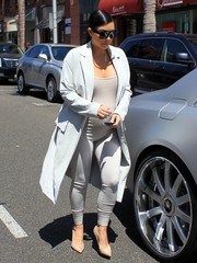 Kim Kardashian smartened her casual outfit with a gray coat.