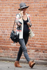 Nicky Hilton cozied up in a striped cardigan for a day out in New York City.