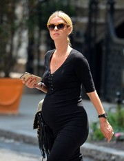Nicky Hilton went out for a walk in Soho wearing chic tortoiseshell cateye sunnies.
