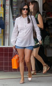 Rachel Bilson teamed her casual blouse/shorts combo with a pair of embellished pink pumps by Jimmy Choo.