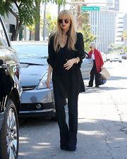 Rachel sported a black blazer over her tunic and jeans while out in Beverly Hills.