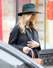 Rosie Huntington-Whiteley accessorized with a two-tone fedora by Maison Michel while out shopping in New York City.