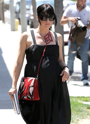 Actress Selma Blair strolled the streets of Hollywood in all her pregnant glory toting an anthurium flower-print bag from the Spring 2011 collection.