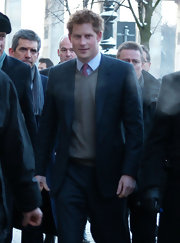 Prince Harry looked handsome in Berlin wearing a beige v-neck sweater over his tie.