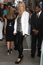 Heidi Klum finished off sexy black leather pants and sequin tank with sky-high platform pumps.