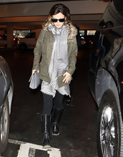 Rachel Bilson donned flat black knee high leather boots at LAX.