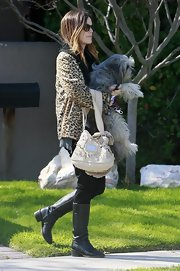 Rachel Bilson was pulling double duty while carrying her shaggy dog and pricy Valentino bag. She managed to carry both in the same hand while heading out from a friends house.