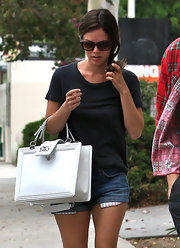 Rachel Bilson's sunnies are a mix between cateyes and wayferers and we can't help but love it.