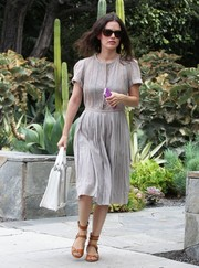 Rachel Bilson paired her dress with strappy tan sandals by Chloe.