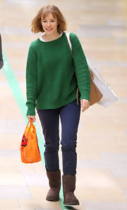 Rachel McAdams kept her look casual and comfy with an emerald green knit sweater.
