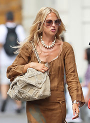 Stylist to the stars Rachel Zoe paired her tan maxi dress with a quilted Flap bag.
