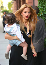 Rachel Zoe is all about unique accessories like this gold tassel necklace.