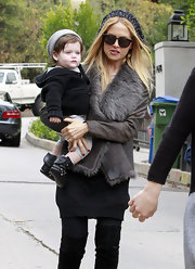 Accompanying Mom Rachel Zoe as she made her way to a friend's house in LA, Skyler kept cozy in a black hooded cardigan.