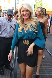Gretchen Rossi cinched her waist with a gold-adorned elastic belt at her 'Extra' interview in LA.