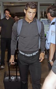Cristiano travels with a hard-top black rollerboard bag.