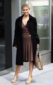 Joanna Krupa chose this basic black wool coat for her chic and stylish street style.