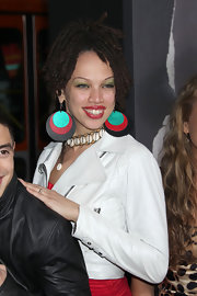 Naima Adedapo added a dash of color to her look with wooden multi-colored earrings.