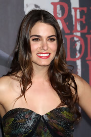 Nikki Reed framed her face with long flowing curls at the premeire of 'Red Riding Hood.'