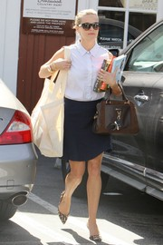 Reese Witherspoon teamed a sleeveless white button-down with a navy mini skirt for a meeting in Brentwood.