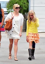 Ava's black boots and peach ruffle skirt are a cute combination.
