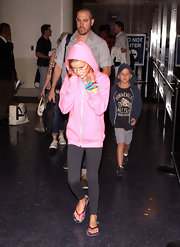 A camera-shy Ava got a little help from her pink hoodie.
